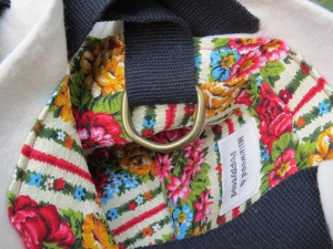bright vintage floral stripe interior with D-ring accessory and slip pocket