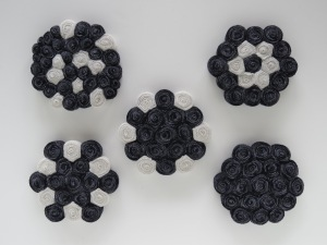 """a set of five, yet no two alike; 100% Merino wool coasters made from a navy blue/grey/white stripe and a creamy white; each approximately 5"""" diameter x 3/4"""""""