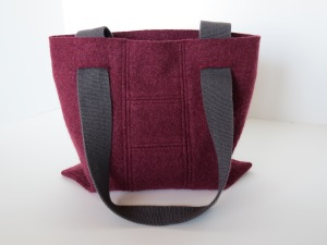 This bag has a great raspberry color, and I love the stitching on the back where I pieced together the little scraps.