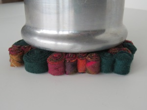 Perfect size for a mug or teapot, or for under a vase.  https://www.etsy.com/listing/208358026/standing-wool-trivet-green-red-plaid