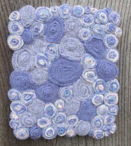 With my leftovers, I made this small wallhanging. Struggling with good photos of this color. Here it is hanging outside on a dreary grey day.