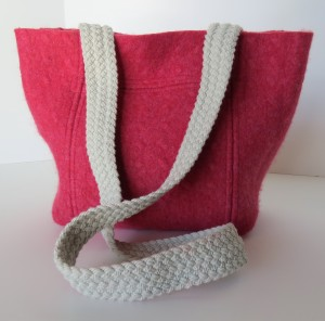 Thick pink lambswool with a vintage floral print lining. Do women actually carry pink bags? Maybe this is for a teenager.