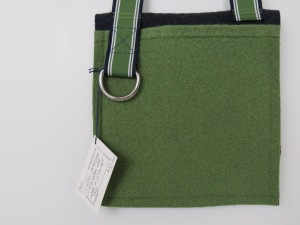 This one is a flat sack, with a back pocket and a pocket under the blue button flap.