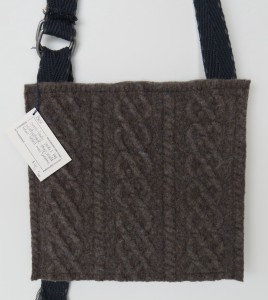 The back panel is same thick cable knit.