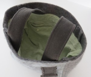 And inside is a light green linen, with lots of shirt features left over. There's a two-section slip pocket.
