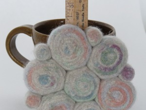 I was able to make a small trivet and one mug rug. Pretty pastels for spring.