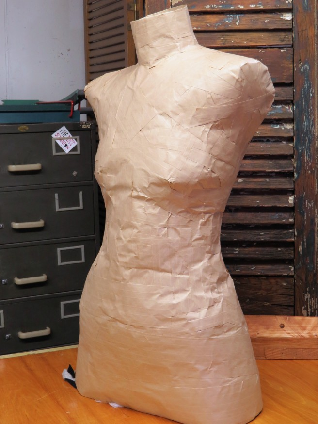 And here she is at the end of the day. I'm not finished yet, but ran out of steam. My shoulders are crooked, and she's even more flat chested than I am! Now I need to decide what to cover her with and how to attach to that old stand.