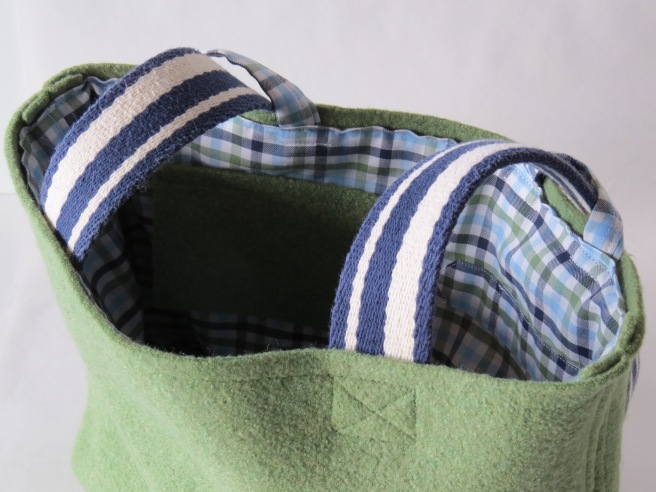 Green merino wool on the outside. Soft cotton on the inside.
