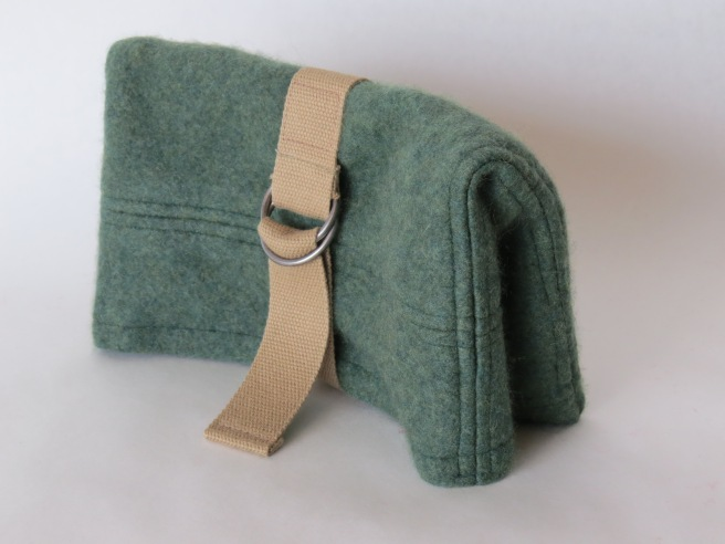 This is my second cashmere clutch. I like it better. Figured out the belt/strap closure. And this one stands on its own.