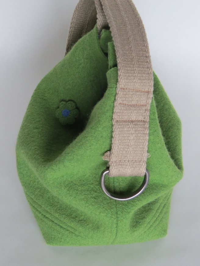 I fell in love with this bag. A nice bucket-ey shape in green merino with holes that I found after I made the bag.
