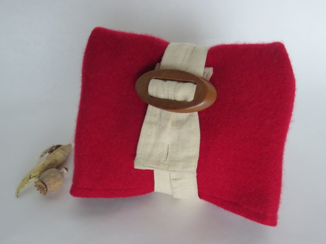 And today I used the first one on another fold-over clutch. I love these little cuties.