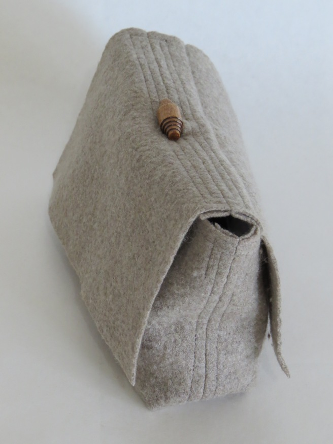 This soft, lightweight clutch is merino on the outside, linen on the in! And I love the lack of color. But that's just me.