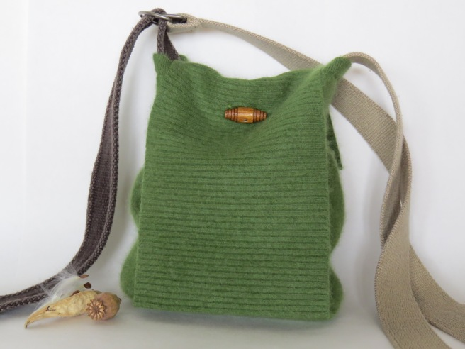 cashmere flap front bag with a barrel button closure