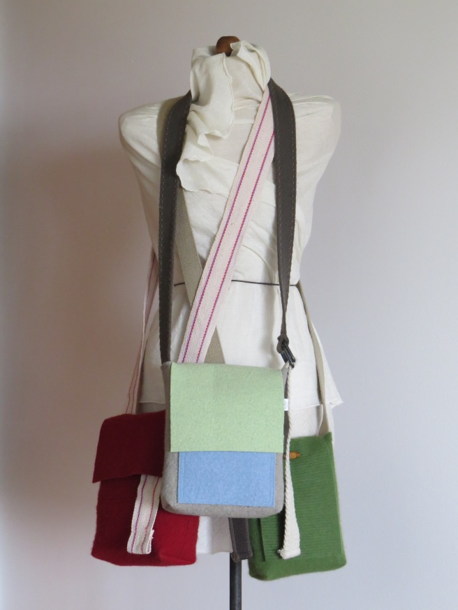 Three recent cross body bags, smaller interior sizes with long, adjustable straps; all reclaimed and repurposed materials, as always.